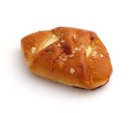 Broodje dat met kwark wordt gevuld Stock Foto