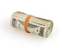 Broodje van geld op witte achtergrond stock afbeelding