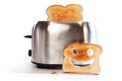 Broodrooster met plakken van toost Stock Afbeeldingen
