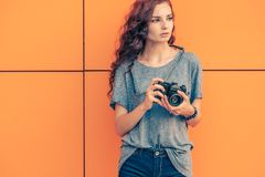 Broody Hipster Girl Photographer Looking Away With Vintage Film Camera In Her Hands stock image