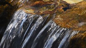 Brook clear water stream with small rift. Brook clear transparent water stream with small rift in day time stock footage