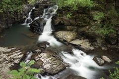 Brook flowing from waterfall. Brook flowing on rock mass from waterfall in Kumamoto Royalty Free Stock Photo