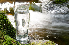 Brook and glass Royalty Free Stock Photography