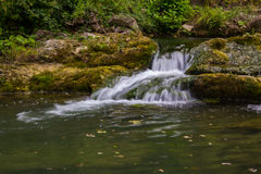 Brook with a little waterfall in Tuscany Stock Image