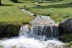 Brook in the meadows. Of green grass surrounded by trentino south tyrol stock photo