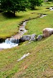 Brook in the meadows. Of green grass surrounded by trentino south tyrol stock photography