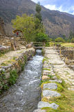 Brook running through old Inca ruins Royalty Free Stock Image