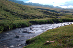 Brook. Small brook in the mountains, Naryn region, Kyrgyzstan Royalty Free Stock Images
