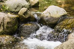 Brook with stones Royalty Free Stock Images