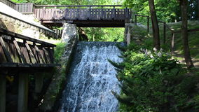 Brook stream flow run old retro water mill bridge cascade stock video