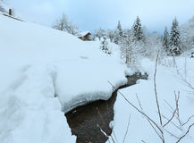 Brook in winter Carpathian Mountains. Royalty Free Stock Photo