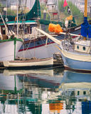 Brookings Harbor, Oregon. Colorful boats with reflections , including sail boats and fishing boats, are moored at Brooking Harbor, in southern Oregon, on the Stock Images