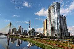 Brooklin and Marginal Pinheiros Sao Paulo Brazil. The ultra modern glass buildings of the Brooklin neighbourhood of the metropolis Sao Paulo with a large red and royalty free stock photography
