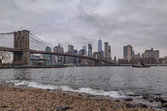 Brooklyn bride from pebble beach. Lower manhattan and brooklyn bridge from pebble beach Stock Images