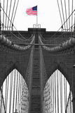 Brooklyn Bridge. The Brooklyn Bridge with the American Flag blowing in the wind Stock Photography