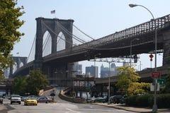 Brooklyn Bridge. The Brooklyn Bridge from a Manhattan Street, taken on a hazy afternoon Royalty Free Stock Photo