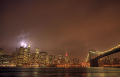 Brooklyn Bridge. At night in the mist of fog Stock Photography