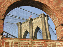 Brooklyn Bridge. Viewed through an old arch Stock Photos