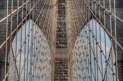 Brooklyn Bridge - Abstract details - New York City. Brooklyn Bridge - the web of suspension cables and the neo-gothic pointed arches of the towers form a Stock Photo