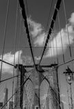 Brooklyn Bridge with American flag in black and white Royalty Free Stock Photo
