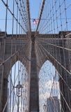 Brooklyn Bridge Archway and US Flag Stock Photo