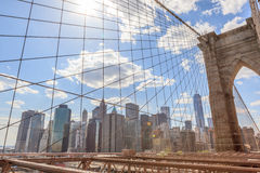 Brooklyn Bridge with background of high office building in New Y Royalty Free Stock Image