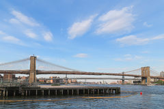 Brooklyn bridge with blue sky. Wide angle view from riverside of Brooklyn bridge on blue sky with slightly cloud Royalty Free Stock Photography