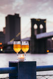 Brooklyn Bridge candle champagne glasses in New York City Stock Images