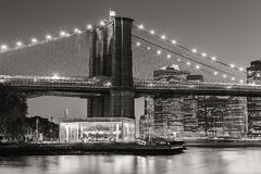 Brooklyn Bridge and carousel at twilight. New York City Royalty Free Stock Photos