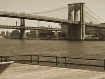 Brooklyn Bridge Duo-tone. This is a sepia toned shot of the Brooklyn Bridge and the East River in Manhattan Royalty Free Stock Images