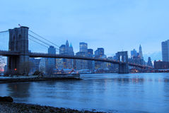 Brooklyn Bridge at Dusk. This is a shot of the Brooklyn Bridge. Manhattan is seen in the background. The image was shot just before the sunset (sun not seen in Stock Image