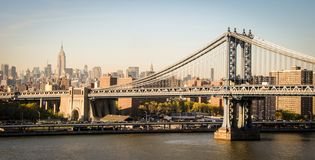 Brooklyn bridge and empire state building in New York stock photography