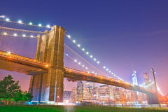 Brooklyn Bridge, famous New York City landmark. And Manhattan downtown financial district at sunset Royalty Free Stock Photography
