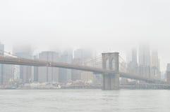 Brooklyn Bridge at fog. Stock Images