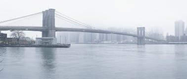 Brooklyn Bridge at fog. Panoramic view of Brooklyn Bridge at foggy day Royalty Free Stock Image