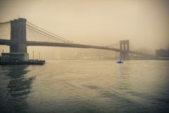 Brooklyn bridge at foggy evening Royalty Free Stock Photo