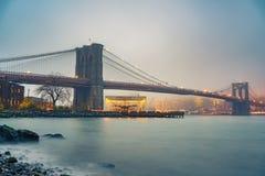 Brooklyn bridge at foggy evening. Brooklyn bridge and Manhattan at foggy evening, New York City royalty free stock photos