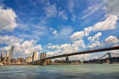 Brooklyn bridge, Hudson river and the island of Manhattan, New York skyline USA stock photography