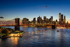 Brooklyn Bridge and illuminated Manhattan skyscrapers at Twilight. New York Stock Images