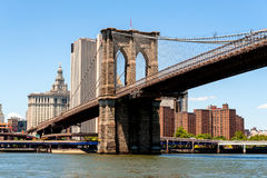 Brooklyn Bridge and Lower Manhattan. As seen from the Brooklyn side of the East River is the Brooklyn Bridge. Visible here is the western most tower of the Stock Photos