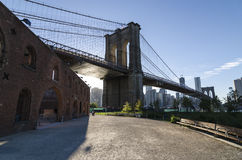 Brooklyn Bridge and Lower Manhattan. Facing south is this view of the Brooklyn Bridge as seen from Brooklyn Bridge Park. As a backdrop in the distance is the Stock Photo