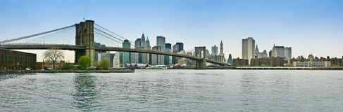 Brooklyn bridge and lower Manhattan panoramic view. Panoramic view of Brooklyn bridge, lower Manhattan and financial district, New York Stock Photo