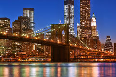 Brooklyn Bridge with lower Manhattan skyline at night Stock Images