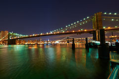 Brooklyn Bridge with lower Manhattan skyline at night. Brooklyn Bridge with lower Manhattan skyline in New York City at night Stock Images