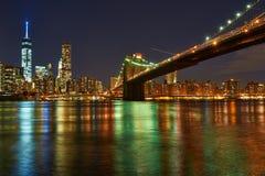 Brooklyn Bridge with lower Manhattan skyline at night Stock Photos