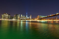Brooklyn Bridge with lower Manhattan skyline at night. NEW YORK CITY - APRIL 2: Brooklyn Bridge with lower Manhattan skyline in New York City at night, USA Royalty Free Stock Photos