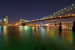 Brooklyn Bridge with lower Manhattan skyline at night. NEW YORK CITY - APRIL 2: Brooklyn Bridge with lower Manhattan skyline in New York City at night, USA Royalty Free Stock Photography
