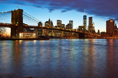 Brooklyn Bridge with lower Manhattan skyline at night. NEW YORK CITY - APRIL 2: Brooklyn Bridge with lower Manhattan skyline in New York City at night, USA Stock Photography