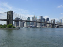 Brooklyn Bridge and Manhattan. Viewed from the Brooklyn side near the East River stock images