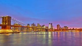Brooklyn bridge and Manhattan at dusk. New York City Stock Photo